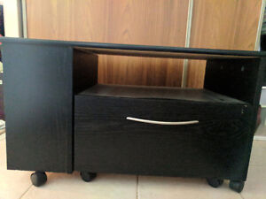 Black TV stand on wheels - pick up only
