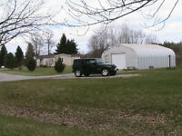 Bungalow 1.6 acres landscaped across from Rideau Lakes