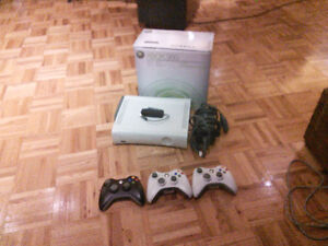 Xbox 360  w/ 3 controllers, 9 games and usb wifi adapter