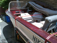 14 Ft Runabout With a 1962 Evinrude 28hp Tilt Motor  & Trailer