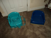 Booster Seats $10 for light blue one $5 each for blue and yellow