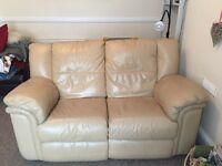 Cream leather reclining 2 seater sofa