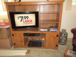 """Wooden TV cabinet 50"""" wide by 48"""" tall by 17"""" deep."""
