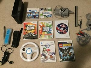 Like New Neuf Wii avec jeux, 2 controller, Mario Kart, HD output