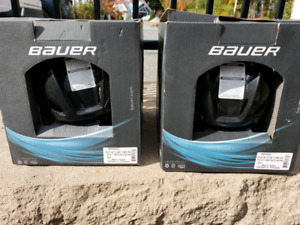 Two brand new kids hockey helmet size youth.