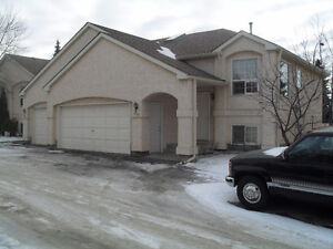 Spacious 2 Bedroom Townhouse with double attached garage