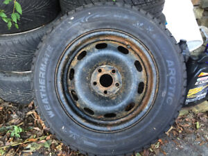 205 65r15 brand new. Never used. On rim tires.