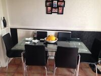 Glass Dinning Room Table and 6 chairs