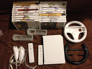 Selling a Wii with 2 Controllers + Nunchuks+20 Games! *Reduced!*