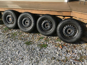PRICE REDUCED FOR QUICK SALE!! 4 STUDDED TIRES ON RIMS