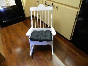 AN OVER SIZE CHILDRENS ROCKING CHAIR