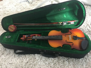 Violin - with the case, the bow, rosin and the shoulder rest