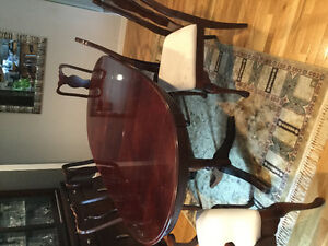Solid cherry wood dinning table and 6 chairs
