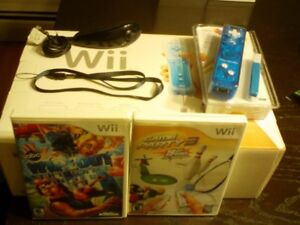 Wii system Blue works great in box, barey used $70 with 2 games