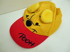 Disney Items: Pooh hat and magnet, Ariel wallet, Golden Books
