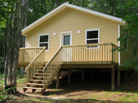 NEW COTTAGE/CABIN BUILT ON A LARGE WOODED PRIVATE LOT IN THE HIL