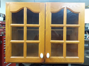OAK CABINET WITH GLASS PANEL DOORS