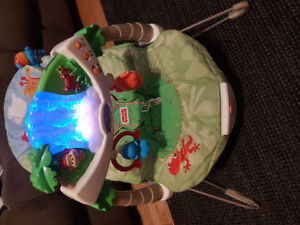 Vibrating bouncy seat with light up toy bar
