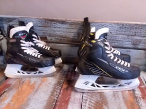 (2) pairs of like new skates size 4 &9 with matching helmets!