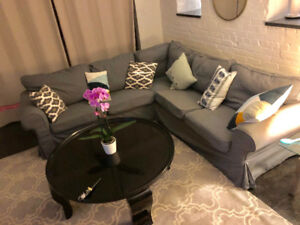 Dark grey Ektorp sectional couch and round coffee table