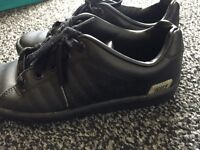 Black Nike trainers in UK size 4
