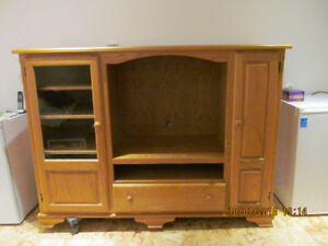 Oak Entertainment Unit for T.V. and shelves and glass doors.