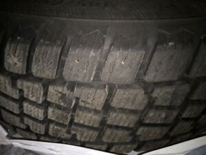 FOUR (4) 185/65R15 WINTER TIRES ON RIMS READY TO BE INSTALLED