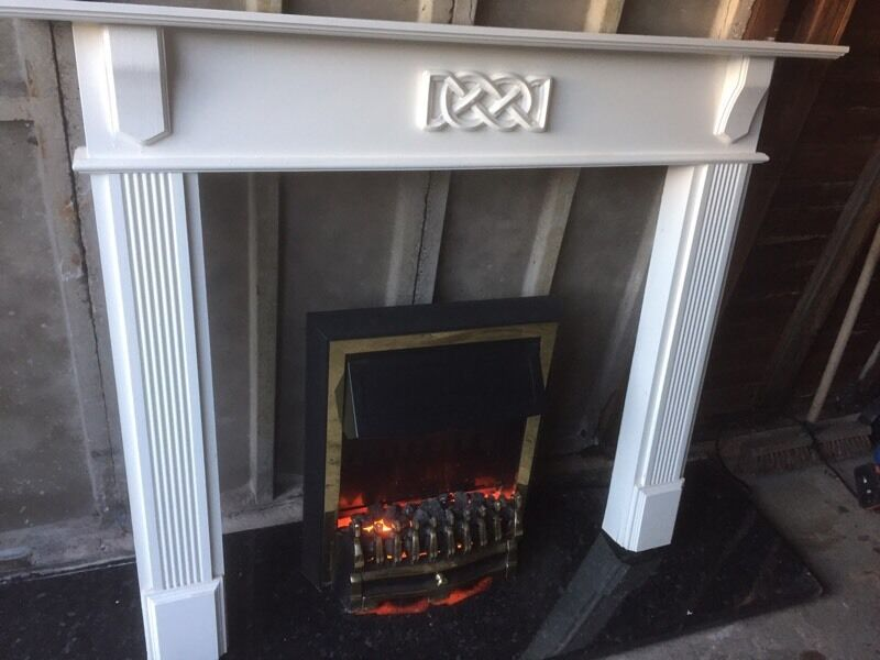 Wood fire surround plus electric firein Leeds, West YorkshireGumtree - Wood fire surround an electric fire for sale both in good condition, can deliver for a small change