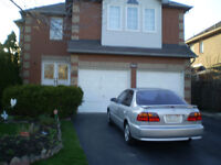 Large Room in an Executive Home Available Now