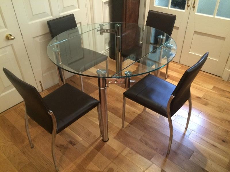 Cargo Glass Dining Table And Faux Leather Brown Chairs