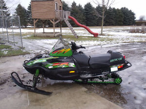 Arctic cat 500 willing to trade