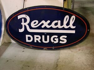 1920's Rexal Drug Store Sign w/ Steel Ring and Hangers