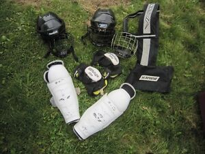various hockey gear and sports carrier