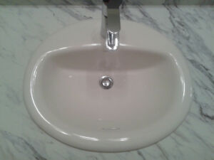 4 white overmount sinks and laminate countertops