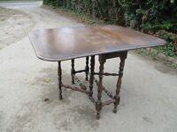 Wooden, polished Gateleg Table