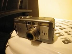 **Powershot S40 camera with charger, manual and leather case...