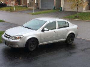 2010 Chevrolet Cobalt Sedan with 4new snow tires(on rim)