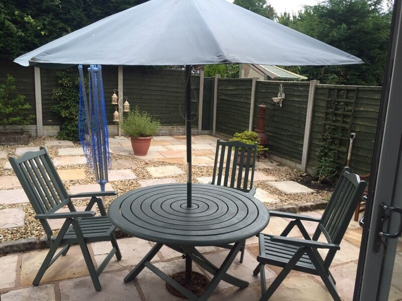 Rose wood outdoor table chairs and umbrella in Preston Lancashire