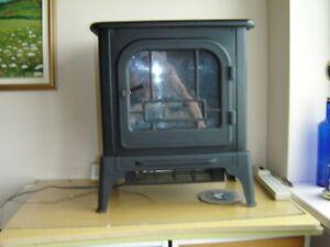 petit foyer  avec chauffage tres pratique