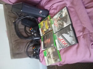 Hardly used Xbox 360 250 gig with 2 controllers and 5 games