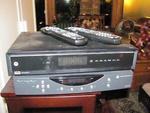 TWO SHAW CABLE INTERNET BOXES WITH REMOTE asking $35 both or bes