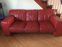 Red settee 3 seater and 2 single chairs.