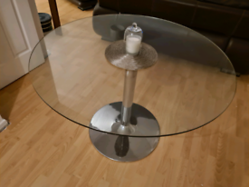 Round glass table with chrome stand
