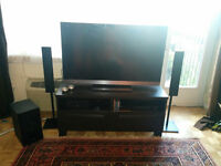 Sony home theatre set - TV, TV bench, and powerful sound system