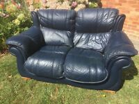 Cheap blue leather sofa. Can deliver.