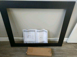 Electric fireplace insert installation kit.