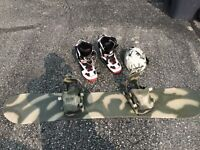 Camouflage snowboard and helmet with boots