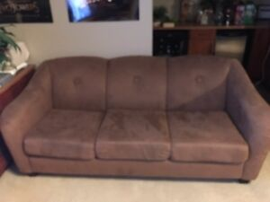 Former designer couch , has some miles on it