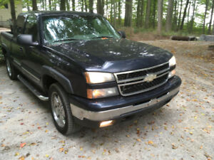 2006 Chevy Silverado trade for sled or quad or cash