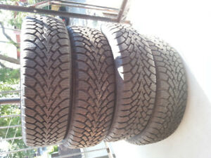 4 winter tires, used 1 season. Goodyear. P215/65R16. Grade 12 -